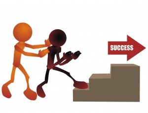 Pushing someone up the stairs to success